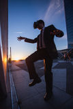 Businessman playing martial arts simulation Stock Image