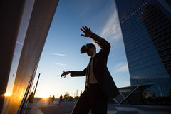 Businessman playing martial arts simulation Royalty Free Stock Images