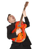 Businessman  playing on orange electric guitar Stock Photo