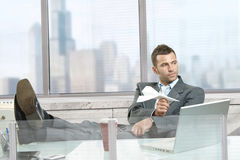 Businessman playing with paper airplane Royalty Free Stock Image