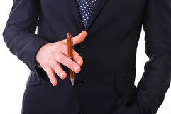 Business man playing with pen. Stock Images