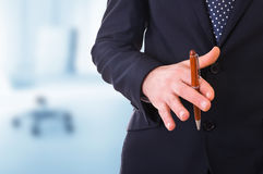 Business man playing with pen. Royalty Free Stock Photography