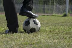 Businessman playing with soccer ball, Asian businessman with football in the stadium foolball, Soccer ball royalty free stock image