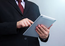 Businessman playing tablet- Hand Focused Stock Photos