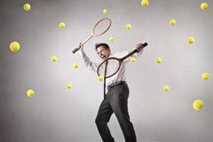 Businessman playing tennis stock photo