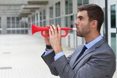 Businessman playing the trumpet isolated Stock Photo