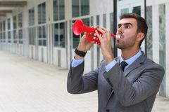 Businessman playing the trumpet isolated Royalty Free Stock Photography