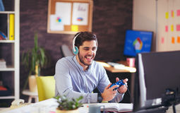 Businessman playing videogames in his office Stock Images