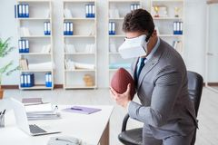 Businessman playing virtual reality football in office with VR g Stock Photography