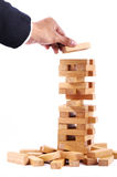 Businessman playing with the wood game (jenga). Stock Image