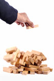 Businessman playing with the wood game (jenga). on white backgro Royalty Free Stock Photography