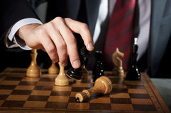Businessman plays chess Stock Photos