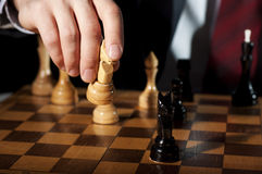 Businessman plays chess Royalty Free Stock Image
