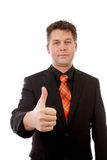 Businessman is pleased with thumbs up Royalty Free Stock Photos