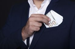 Businessman pocket money in his pocket royalty free stock images