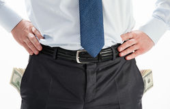 Businessman with pockets full of dollars Royalty Free Stock Photo