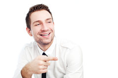 Businessman poinging at someone. Successful happy businessman pointing at someone. Isolated on white Royalty Free Stock Image