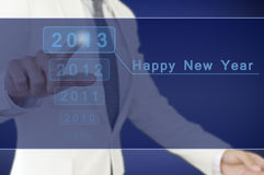 Businessman Point 2013 Happy New Year Stock Photo
