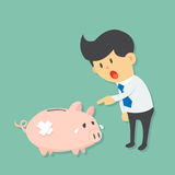 Businessman point and ask sad injured piggy bank for his or her problems. Risk corruption cry Royalty Free Stock Photography