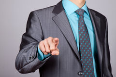 Businessman point finger Stock Images