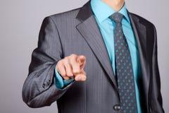 Businessman point finger Stock Images