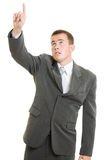 Businessman point a finger Stock Photography