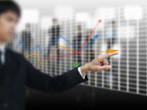 Businessman point graph Royalty Free Stock Photos