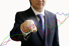 Businessman point the graph Royalty Free Stock Photo