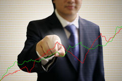 Businessman point the graph on the air Royalty Free Stock Image