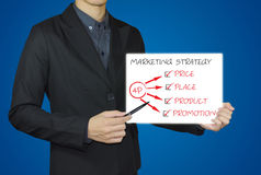 Businessman point with pen drawing graph marketing strategy. Businessman point with pen drawing graph 4P marketing strategy on whiteboard Stock Photo