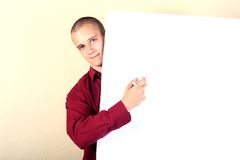 Businessman point at table Royalty Free Stock Image