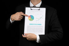 Businessman point to marketing graph .Document is mock up Royalty Free Stock Photography
