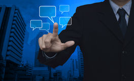 Businessman point to social chat sign and speech bubbles over ma Stock Images