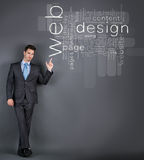 Businessman point at web design words Royalty Free Stock Image