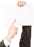 Businessman pointimg at small blank paper Stock Photography