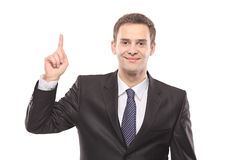 A businessman pointing. Isolated on white background stock image