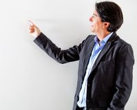 Businessman pointing Royalty Free Stock Images