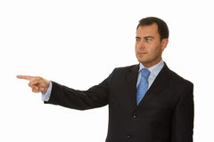 Businessman pointing. Portrait of a young business man pointing Royalty Free Stock Photography