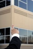 Businessman pointing. To a building Stock Photos
