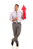 Businessman pointing arrow symbol Stock Photos