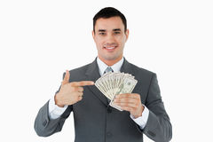 Businessman pointing at bank notes in his hand Stock Images