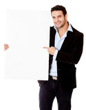 Businessman pointing at a banner Stock Photo