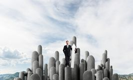 Businessman and pointing banner royalty free stock photography