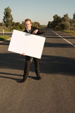 Businessman pointing on billboard Stock Images
