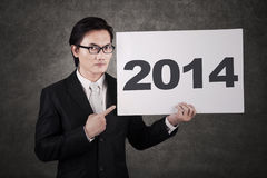 Businessman pointing a 2014 billboard Royalty Free Stock Image