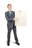 Businessman  pointing at blank canvas Stock Image
