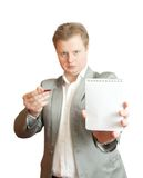 Businessman  pointing at blank notebook Stock Photography