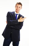 Businessman pointing at blank panel Stock Photo