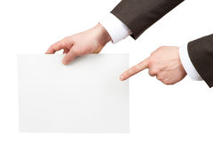 Businessman pointing at blank paper Stock Photos