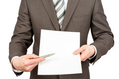 Businessman pointing at blank paper with pen Royalty Free Stock Photography